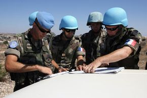 Soldiers from the French Foreign Legion consulting a map along the southern Lebanese border. France sent Legionnaires to help rebuild Lebanon after the Hezbollah-Israel war in 2006. See more soldier pictures.
