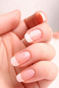 A French manicure has to be perfect to look right -- no bumps, wavy lines or steaks.