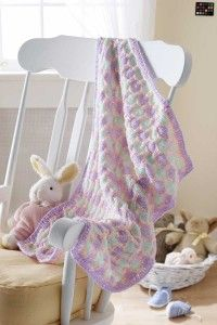 The deceptively easy-to-knit honeycomb blanket will soon become baby's favorite.