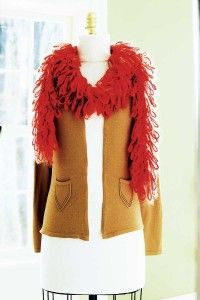 Long loops instead of feathers -- The knitted boa is very stylish.