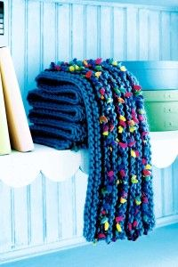 Like colored popcorn, texture in the yarn pops out all over this scarf.