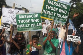 """Indian Muslim children shout anti-US slogans as they participate in a protest meeting against the film """"Innocence of Muslims."""" In many countries, it is against the law to criticize or """"blaspheme"""" a particular religion or religions in general."""