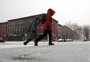 A couple walks to the subway in the snow and sleet in the Brooklyn borough of New York City.