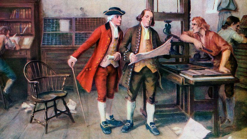 Benjamin Franklin confers with two colleagues at his printer's shop. Franklin's brother was imprisoned for printing material that offended the British government. GraphicaArtis/Getty Images