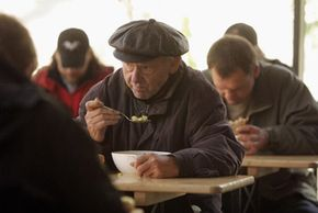 Gleaning organizations help feed the homeless with recovered food.