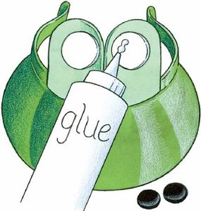 Glue the black circles to the white eye circles.