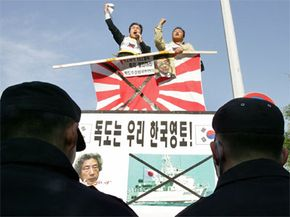 Protesters in South Korea in 2006 demonstrate against Japan's plan to send survey ships into waters claimed by both countries. The disputed waters are a rich fishing ground and were thought to have methane hydrate deposits.