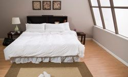 If you don't spend many of your waking hours in the bedroom, there's no need to clutter it up with furnishings that won't get used.