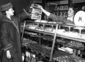 Prima ballerina Margot Fonteyn buys panettone, an Italian version of fruitcake.