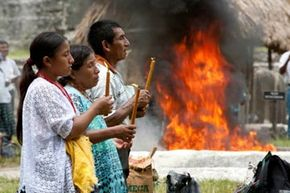 Guatemalans take part in a Mayan ceremony.  The Mayan culture is still a big part of Guatemala. See more pictures of Mayan culture.
