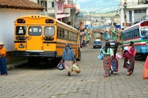 Streetlife in a Guatemalan village.  Note the people wearing traditional clothing.