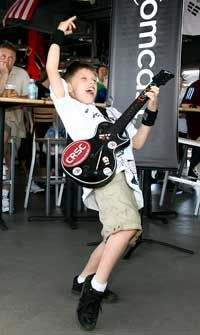 Garrett Ellwood/MLS via Getty Images Kid rock: Will this tiny rocker's Guitar Hero skills translate to the real instrument? See more guitar pictures.