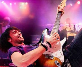 Guitar Hero won't instantly make you a real life rock star, but it can teach you some fundamentals of guitar playing.