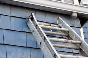 It's best not to lean your ladder up against your gutters while you're working because the weight of the ladder with a person on it can dent -- or worse, crack -- them.