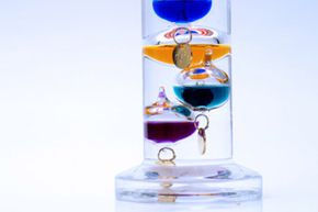 Galileo's thermometer used various gases and water to measure temperature.