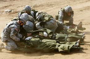 South Korean and U.S. soldiers take part in a Medical Evacuation (MEDEVAC) field training exercise in Yangju, South Korea. Game theory suggests that in war, a soldier's best option is to fight -- even if it means sustaining an injury.