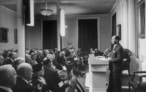 """John von Neumann, co-author of """"Theory of Games and Economic Behavior,"""" gives an extemporaneous lecture on computing machines before the American Philosophical Society."""