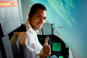Flight simulators like the F-18 simulator this man's operating have been used to train pilots for years.