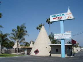 Often a gas station, motel, or restaurant uses a huge statue or other gimmick to lure customers.