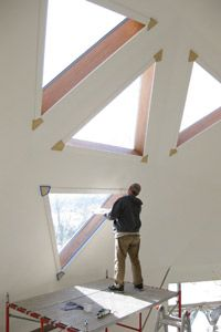 The triangular windows of this home serve as a reminder of the geometric shape that helps make this dome structure so strong.
