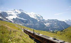 Train running through the mountains of Switzerland