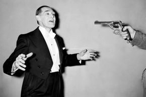 Magician George Grimmond performs a bullet catch trick in 1958 similar to the one that killed Madame DeLinsky 138 years earlier.