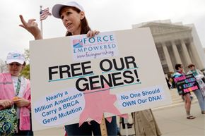 Lisa Schlager of Chevy Chase, Maryland, demonstrates outside of the Supreme Court as arguments were made in a case seeking to determine whether human genes can be patented.