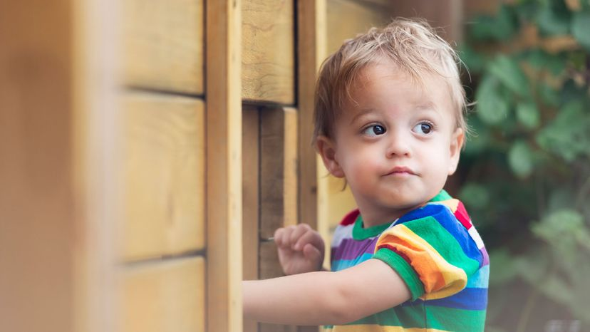 kid in rainbow shirt