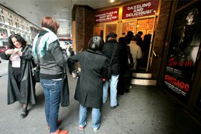 """Theatergoers in New York line up for tickets to see the Broadway musical """"Chicago."""""""