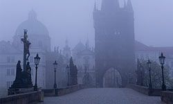 The haunted Charles Bridge disappears into the fog. Do you dare cross it?