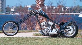 Girder chopper's custom girder forks were stretched 22 inches and cloaked in black. See more motorcycle pictures.