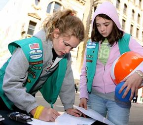 Girl Scouts make signs at the Lynx Block Party prior to the game between the Minnesota Lynx and the Detroit Shock.