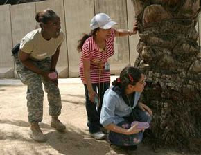 Iraqi Girl Scoutsparticipate in awater balloon fightduring an activity day at theU.S. embassy pool, formerly palace of Saddam Hussein, in Baghdad's Green Zone in August 2008.