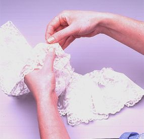 Sew a row of running stitches to secure the lace.