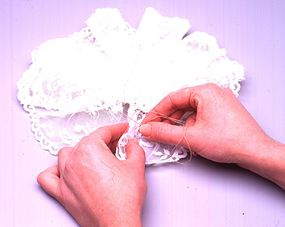 Sew the edges of the lace closed.