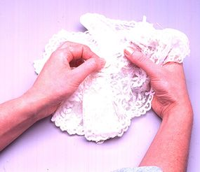 Use a pin to thread the elastic through the lace.