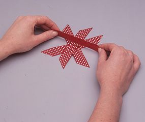 Glue the ribbons together at the center.