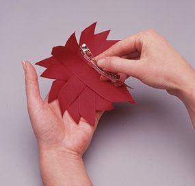 Glue the pinwheel to the barrette.