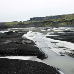 In this photo, you can see the cloudy meltwater caused by rock flour. Iceland, Myrdalsjokull Glacier.