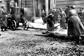 During World War I, women did many jobs traditionally held by men. Here, a group of women are resurfacing a city street in London. Even in the 21st century, it would be rare to see a woman doing this type of work.