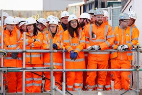 Construction workers, including three females in the front, await the arrival of Queen Elizabeth II for a visit to the Crossrail station site at Bond Street, London, in 2016. Women make up just 3 percent of U.S. construction workers.
