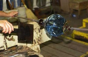 To get the beautiful blues and other colors in blown glass, special ingredients can be added to the batch, or melted and fused on later.