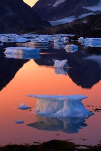 An iceberg floats in the bay of Kulusuk, Greenland. The northern ice caps and glaciers are melting.
