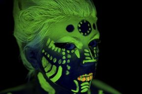 Face paint like this can wash off easily. Want a more permanent luminescent design? That's possible, thanks to glow-in-the-dark tattoos.