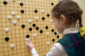 Though the game might tax the patience of some kids (and some adults), children as young as five can learn to play Go.