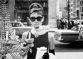 Image Gallery: Changing Tides of Fashion Audrey Hepburn as Holly Golightly peers into a Tiffany storefront window. Her iconic style is still associated with Tiffany's decades later. See more pictures of fashion in history.