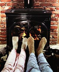 Wood burning stoves are a great way to warm your tootsies.