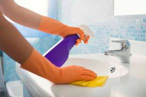 Leaving out some cleaning spray  by the sink may encourage everyone to wipe up after themselves.
