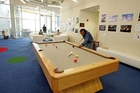 Google employees can take a break and play a quick game of pool or foosball.