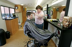 A Google employee gets a free haircut on site.